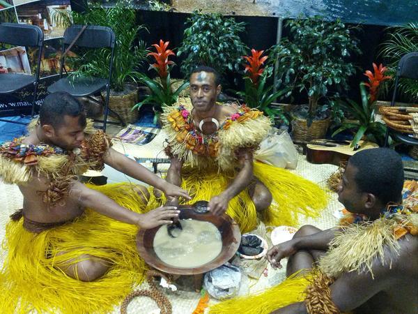 Jesom Tuikana, Joji Ramasima and Paula Rokotuiveikan Nabuta prepare the ceremonial kava drink.