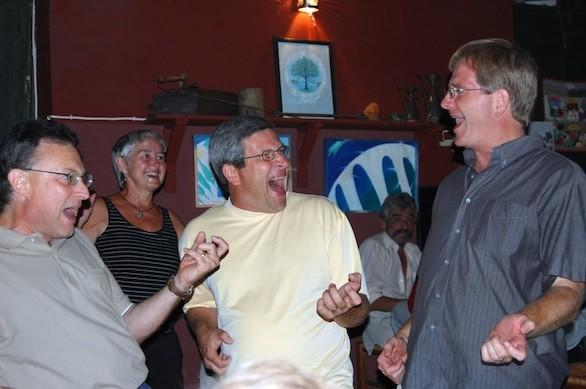 Travel guide author and European expert Rick Steves makes friends in a Greek tavern.