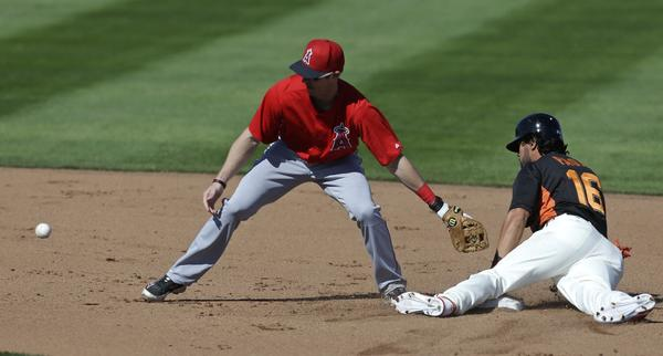 Andrew Romine doesn't get the throw in time as San Francisco's Angel Pagan steals second during the Angels' 4-1 loss Saturday in spring training play.