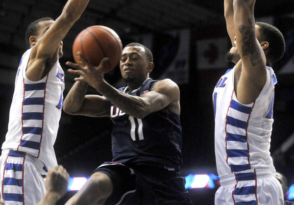 UConn's Ryan Boatright looks to pass between DePaul defenders Cleveland Melvin, left, and Derrell Robertson Jr. at the Allstate Arena Saturday night.