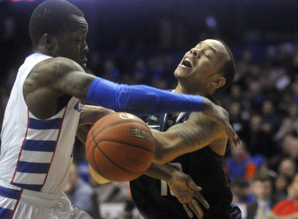 UConn's Shabazz Napier, right, in action against DePaul's Worrel Clahar at the Allstate Arena Saturday night.