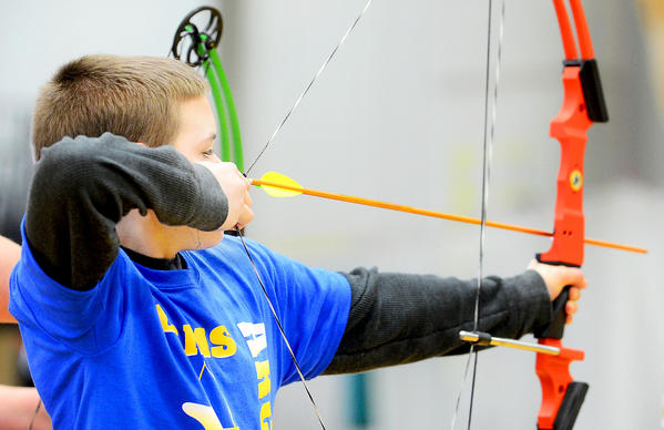 J.T. Miller, a sixth-grader at Clear Spring Middle School, lines up his arrow Saturday afternoon at Hagerstown Community College's Athletic Recreation and Community Center during the 2013 Maryland NASP Tournament.