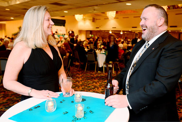 "Lisa Newland, left, and Donny Ravas share a laugh during the cocktail hour of Saturday night's YMCA 2013 Fundraiser ""Toasting the Twenties"" at Hager Hall in Hagerstown."