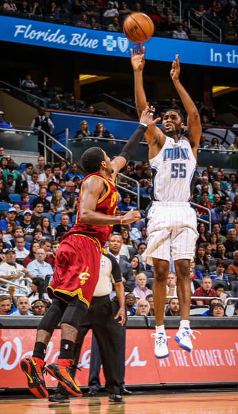 Magic guard E'Twaun Moore (55) shoots a three pointer over Cleveland's Kyrie Irving (2) during third quarter action of a game against the Cleveland Cavaliers at Amway Center in Orlando, Fla. on Saturday February 23, 2013. (Joshua C. Cruey/Orlando Sentinel)