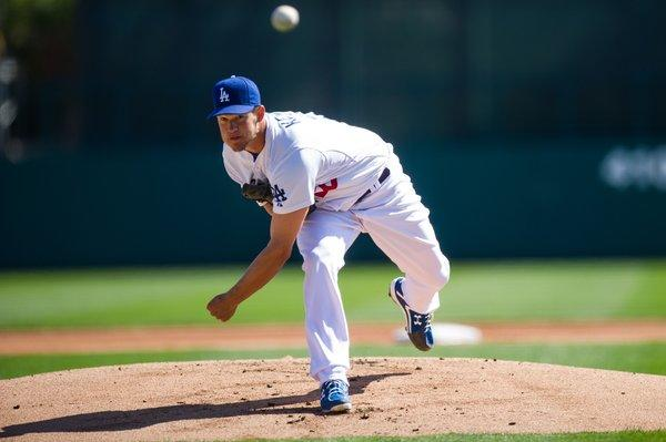 Ace Clayton Kershaw was charged with two runs and four hits in two innings during the Dodgers' spring training opener, a 9-0 loss to the Chicago White Sox.