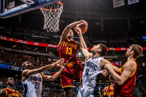 Magic center Nikola Vucevic (9) battles Cleveland's Tristan Thompson (13) for the rebound during second quarter action of a game against the Cleveland Cavaliers at Amway Center in Orlando, Fla. on Saturday February 23, 2013. (Joshua C. Cruey/Orlando Sentinel)