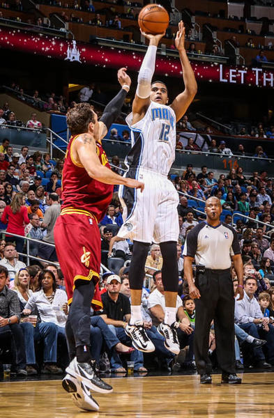 Magic forward Tobias Harris (12) shoots over Cleveland's Luke Walton (4) during second quarter action of a game against the Cleveland Cavaliers at Amway Center in Orlando, Fla. on Saturday February 23, 2013. (Joshua C. Cruey/Orlando Sentinel)