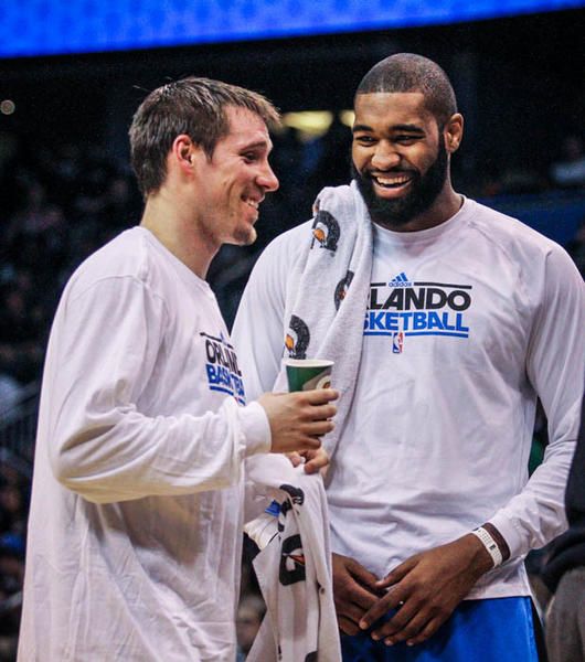 Magic guard Beno Udrih (19) and forward-center Kyle O'Quinn (2) share a laugh during a timeout in the second quarter of a game against the Cleveland Cavaliers at Amway Center in Orlando, Fla. on Saturday February 23, 2013. (Joshua C. Cruey/Orlando Sentinel)