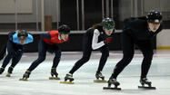 Before they began practice one recent morning in Salt Lake City, Olympic bronze medalist Lana Gehring of Glenview and four other elite speedskaters had to assemble protective pads around the walls of a municipal rink. Working in tandem, the skaters shuttled some 50 pieces of equipment — each resembling an oversized mattress and weighing about 90 pounds — from a storage area onto the ice. Then they slid the pads across the ice and against the walls, like puzzle pieces snapping into place.