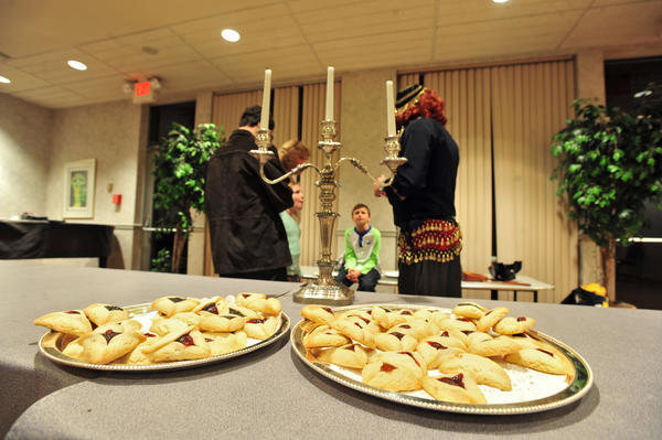 Members of the Keneseth Israel Congregation in Allentown eat hamantaschen, a traditional Purim spiel desert.