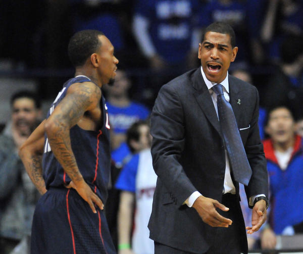 UConn head coach Kevin Ollie has a word with Ryan Boatright at the Allstate Arena Saturday night.