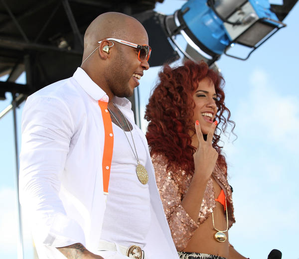 MIAMI BEACH, FL - FEBRUARY 22:  Flo Rida (L) and Natalie La Rose at the Today Show during the South Beach Wine and Food Festival at Loews Miami Beach on February 22, 2013 in Miami Beach, Florida.  (Photo by Aaron Davidson/WireImage)