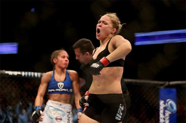 Ronda Rousey celebrates her UFC Bantamweight Title over Liz Carmouche.