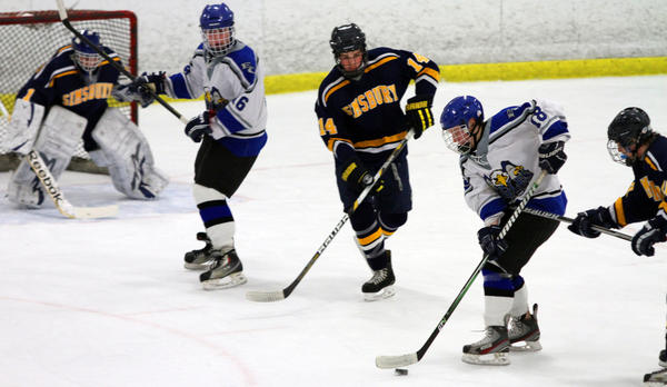 East Catholic's Bill Heaney looks for an opening. Simsbury #14 is Brian Gellman. East Catholic #16 is Mike DiLoreto and Simsbury goalie #1 is Andrew Several. Simsbury won 6-2 at Champions Skating Center in Cromwell.
