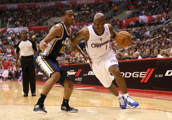 Clippers guard Chauncey Billups drives around Utah guard Alec Burks.