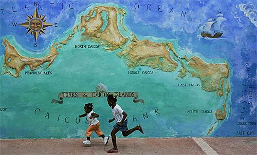 Two girls race past a mural on Providenciales -- Provo, to its familiars -- an island that is the main tourist center of Turks and Caicos Islands, a British crown colony east of Cuba in the Caribbean Sea. At TCI, 33,000 residents share their corner of paradise with about 300,000 tourists annually.