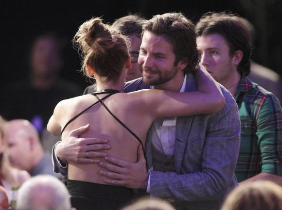 "Bradley Cooper congratulates Jennifer Lawrence for winning the best female lead award for ""Silver Linings Playbook'' at the Independent Spirit Awards Saturday."