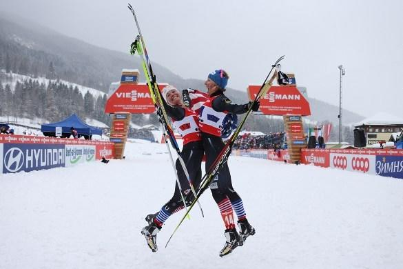 Jessie Diggins (left) and Kikkan Randall jump for joy after their historic win.