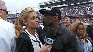 Erin Andrews dodges kiss from 50 Cent on live TV