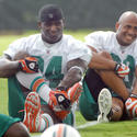 Running Backs Ricky Williams and Patrick Cobbs