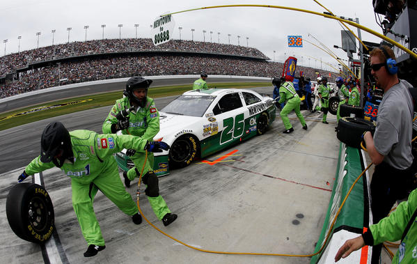 Michael Waltrip, driver of the #26 Sandy Hook School Support Fund Toyota, pits during the NASCAR Sprint Cup Series Daytona 500 at Daytona International Speedway on February 24, 2013 in Daytona Beach, Florida.