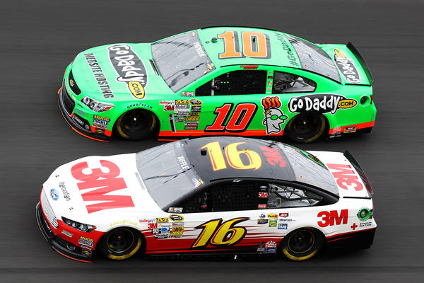 Greg Biffle, driver of the #16 3M FordMobil 1/Burger King, and Danica Patrick, driver of the #10 GoDaddy.com Chevrolet, race during the NASCAR Sprint Cup Series Daytona 500 at Daytona International Speedway on February 24, 2013 in Daytona Beach, Florida.