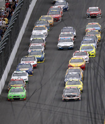 NASCAR driver Danica Patrick (front L) leads the field during the NASCAR Sprint Cup Series Daytona 500 race at the Daytona International Speedway in Daytona Beach, Florida February 24, 2013.