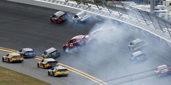 NASCAR drivers Juan Pablo Montoya (42) and Kevin Harvick (29) crash in the first turn during the NASCAR Sprint Cup Series Daytona 500 race at the Daytona International Speedway in Daytona Beach, Florida February 24, 2013.
