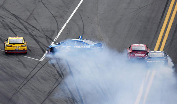NASCAR driver Kasey Kahne (5) turns sideways during a crash in the NASCAR Sprint Cup Series Daytona 500 race at the Daytona International Speedway in Daytona Beach, Florida February 24, 2013.