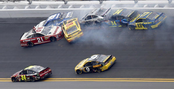 NASCAR driver Trevor Bayne (21) gets turned backwards in a wreck during the NASCAR Sprint Cup Series Daytona 500 race at the Daytona International Speedway in Daytona Beach, Florida February 24, 2013.