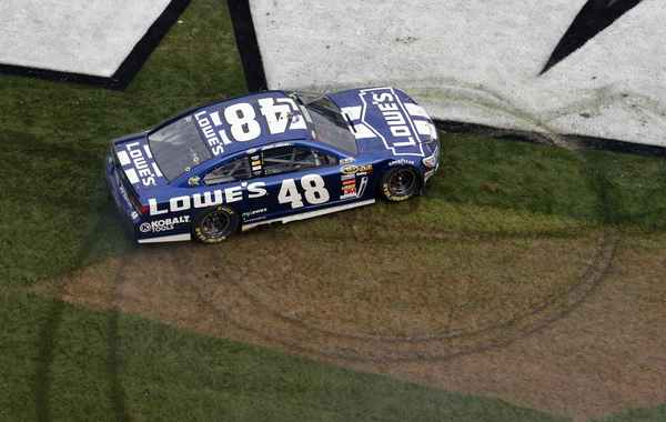 NASCAR driver Jimmie Johnson celebrates after winning the NASCAR Sprint Cup Series Daytona 500 race at the Daytona International Speedway in Daytona Beach, Florida February 24, 2013.