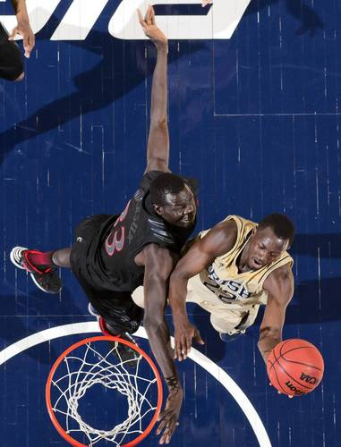 Notre Dame guard Jerian Grant (22) goes up for a shot as Cincinnati center David Nyarsuk (33) defends in the second half at the Purcell Pavilion.