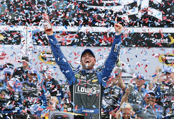 Jimmie Johnson celebrates in Victory Lane after winning the Daytona 500 race on Sunday, February 24, 2013.