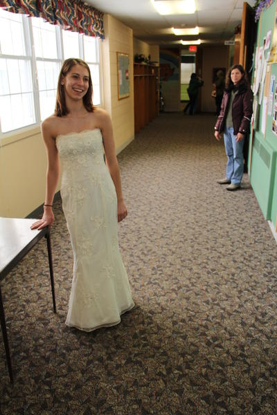 Haley Derlinga, 17, of East Grandy, models one of her potential dress choices at the Dress For Less sale held Saturday at the Enfield Congregational Church, 1295 Enfield St., as her mother Roxanne looks on. The Dress For Less sale offered new and gently used dresses for $27 and the price included a $7 value voucher toward a boutonniere or corsage at the Growth Company and a $20 voucher toward dry cleaning at E-Jays Cleaning.