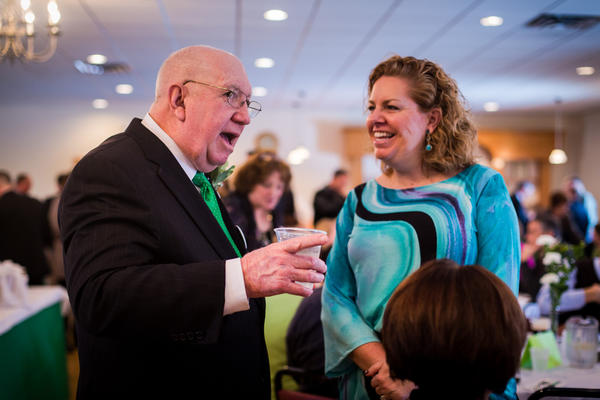 Parade Grand Marshal James Mulcahy talks with his cousin Beth Brown at the 2013 Parade Grand Marshal and Person of the Year Reception at the Irish American Home Society in Glastonbury on Sunday.