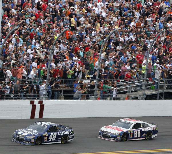 Jimmy Johnson (#48) leads Dale Earnhardt, Jr. (#88) in the sprint to the finish line to win the Daytona 500 at Daytona International Speedway, Sunday, February 24, 2013.