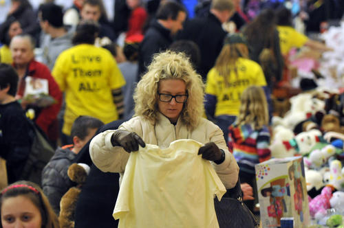 "Organizers and police estimate that nearly 4,000 people attended the ""Community Giveaway"" held by the Town of Newtown Sunday afternoon at Reed Intermediate School in the gym."
