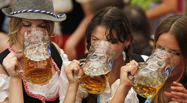 Beer lovers at Oktoberfest in Munich, who probably wished they were playing the Oscars drinking game.