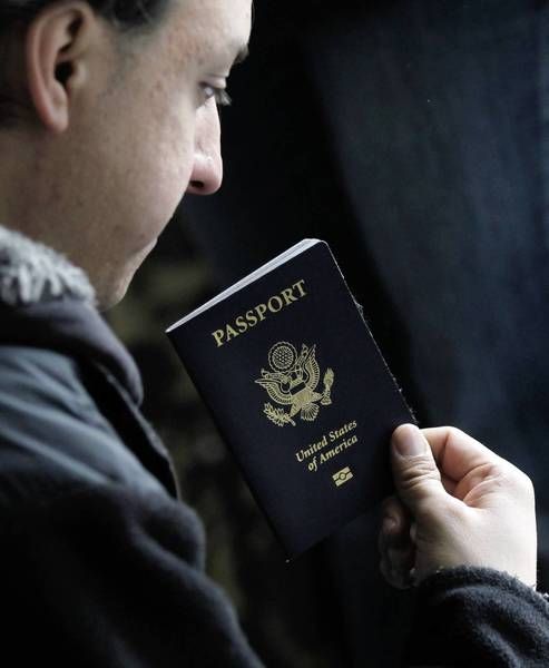 A U.S. citizen holds his pasport in Japan.