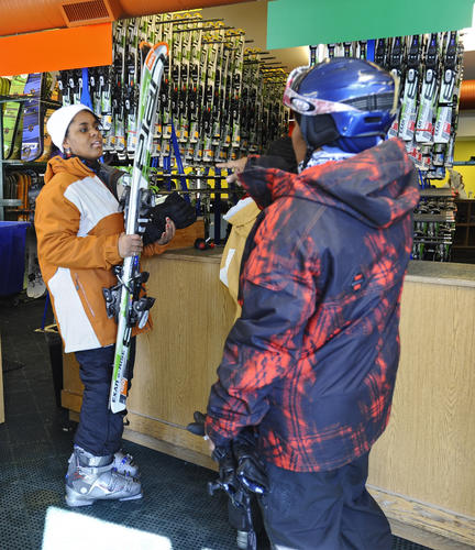 Tahtiana Hyman, 16, of Glen Burnie, picks up her rental skis. Members of the Chesapeake Ski Club take kids from the Salvation Army Boys and Girls Club to the Whitetail Mountain Resort to expose them to the sports of skiing and snowboarding.