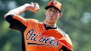 Kevin Gausman began warming up in the fifth inning of the Orioles' Grapefruit League road opener against the Toronto Blue Jays.
