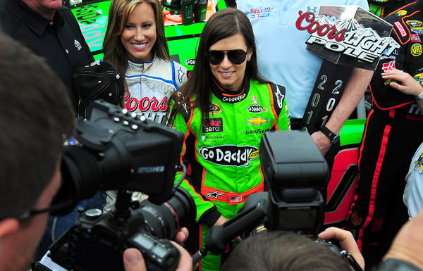 Danica Patrick is engulfed in media as she stands near her car before the start of the Daytona 500 on Sunday.