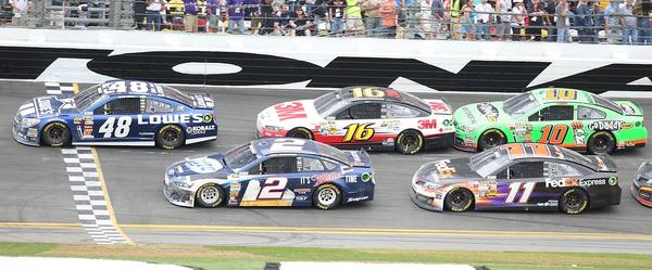 Jimmie Johnson (48), Brad Keselowski (2), Greg Biffle (16), Denny Hamlin (11), and Danica Patrick (7) race during the Daytona 500 race at Daytona International Speedway on Sunday, February 24, 2013.