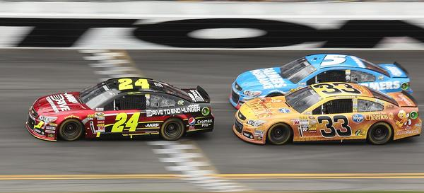 Jeff Gordon (24), Kasey Kahne (5), and Austin Dillon (33) race during the Daytona 500 race at Daytona International Speedway on Sunday, February 24, 2013.