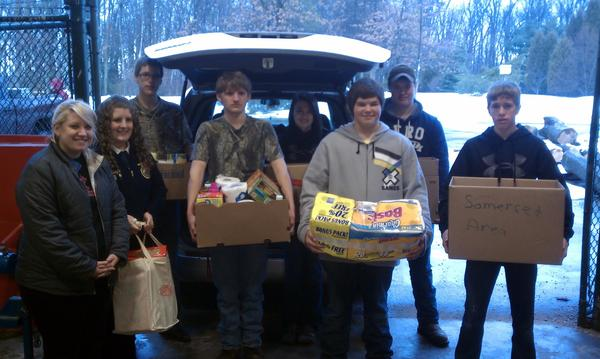 Five FFA Chapters in Somerset County and Somerset County 4-H collected food and money for the Ronald McDonald House in Pittsburgh to celebrate Food Check-Out Day in February. The Somerset County Farm Bureau sponsored the event and collected the donations locally on Tuesday. FFA students who helped with the collection efforts were from left, front: Ashley May and Casey Boyer, both Somerset students; and Somerset County Technology Center students Cody Lenart, Brandon Romesberg, Danny Walsh. Back row: Skylar King, Erin Maust and Jesse Maschue.
