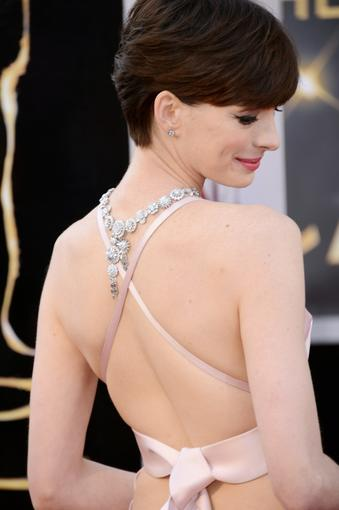 Anne Hathaway also wore her Tiffany & Co. Corsage necklace down her back, showing off the crisscross detail on her icy-pink Prada gown. The effect was modern-day Audrey Hepburn.