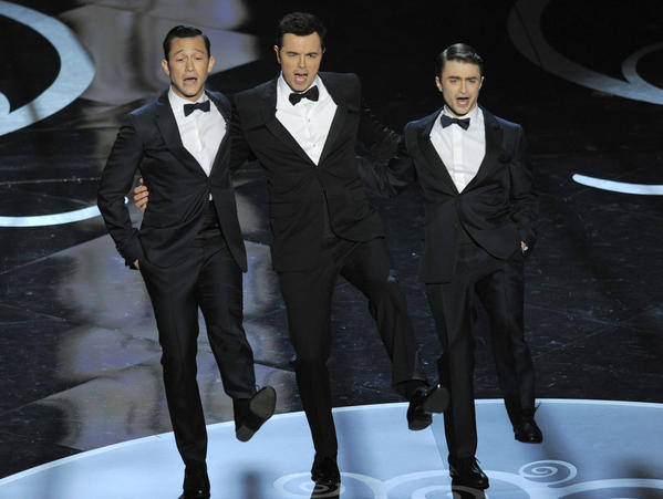 Actors, from left, Joseph Gordon-Levitt, host Seth MacFarlane and Daniel Radcliffe perform during the Oscars at the Dolby Theatre on Feb. 24, 2013, in Los Angeles.