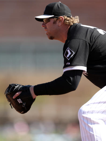 Adam Dunn plays first base against Los Angeles Dodgers on Sunday.