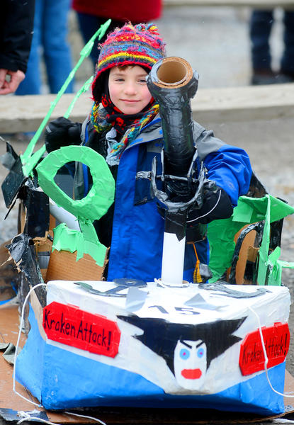 """Ivan Dwyer, 7, of Hagerstown, sits in his cardboard sled named """"Kraken Attack"""" Sunday afternoon after recording a run time of one minute and 18 seconds in the Wild & Wacky Cardboard Sled Derby at Whitetail Ski Resort."""