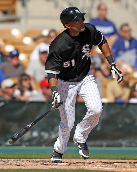 Alex Rios triples in fourth inning against Los Angeles Dodgers on Sunday.